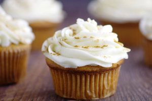 Ginger Brown Sugar Cupcakes with Spiced Cream Cheese Icing-  A homemade delightful twist on traditional carrot cake and spice cake cupcakes recipe from scratch.  A great dessert for Fall gatherings!  Loooove the spiced cream cheese frosting!