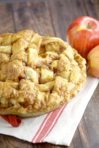 Traditional Apple Pie recipe that won't disappoint. Homemade apple pie with a classic sweet apple pie filling in a flaky pie crust topped with a glaze makes this pie unforgettable. This recipe is seriously the best!