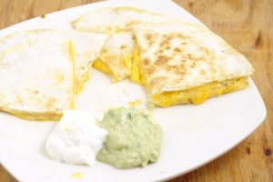 Cheese Quesadillas with Copycat Taco Bell Quesadilla Sauce tastes JUST like the original. From a former Taco Bell worker and current Taco Bell Quesadilla addict. Makes a quick and easy appetizer or dinner recipe too!