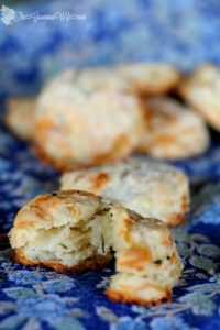 Brie and Chive Biscuits Recipe - Easy homemade buttermilk biscuits with brie and chives. It's so easy to make these amazing, flaky biscuits from scratch! These would be a perfect Thanksgiving side dish. Look how flaky they are!
