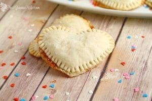 Mini Heart Pies Recipe - an easy dessert pie treat recipe idea. Heart-shaped pies  filled with preserves or apple butter make an adorable treat for your sweetheart. Cute for a Valentines Day treat for kids or a party!