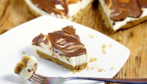 Easy No Bake Smores Cheesecake recipe - a quick and easy no bake smores dessert recipe that can be made from scratch in just 10 minutes! From TheGraciousWife.com