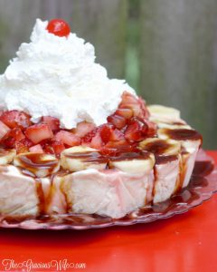 Banana Split Ice Cream Pie Recipe - a no bake pie recipe with graham pie crust, banana swirl ice cream, topped with pineapple, strawberries, chocolate sauce, whipped cream, and of course a cherry! This is so good.  It's seriously the perfect summer treat.
