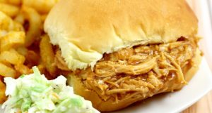 Ridiculously easy Crockpot Barbecue Chicken Sandwiches recipe with just 3 ingredients! Sweet and spicy barbecue with the tang of apple cider vinegar, all in one sandwich in the slow cooker. Top with creamy coleslaw for an extra bit of sweet crunch. Perfect for an easy family dinner idea!