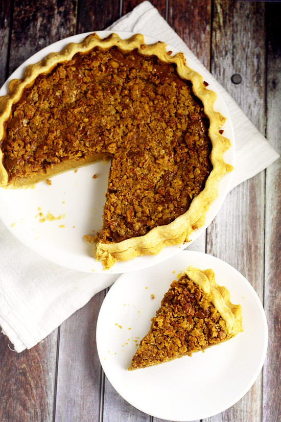 Creamy eggnog and spiced pumpkin come together in this heavenly Eggnog Pumpkin Pie recipe, topped with a crunchy, sweet brown sugar and pecan topping! Omg. Two of my favorites in one delicious pie recipe! Must try ASAP!