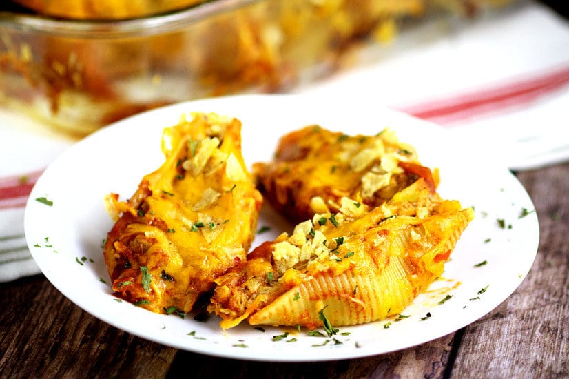 Taco Stuffed Shells Recipe is perfect for a family dinner night! A Mexican-inspired pasta dish, this Taco Stuffed Shells recipe mixes seasoned ground beef in a creamy, cheesy sauce to stuff in shells for a delicious meal. Two family favorites, combined into one!