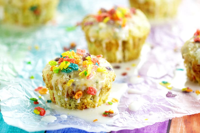 Rainbow Fruity Pebbles Muffins are a pretty fun breakfast idea perfect for St Patrick's Day. Fun and easy to make these Rainbow Fruity Pebbles Muffins with a crunchy streusel topping and sweet, simple glaze will make you feel like you've hit the breakfast jackpot!