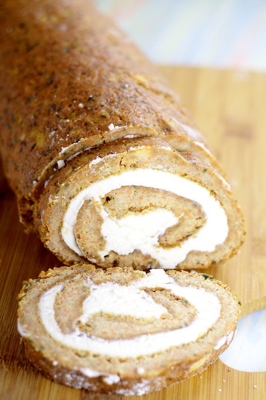 Carrot Cake Roll with cream cheese frosting filling.  Moist, spiced carrot cake rolled up with creamy cream cheese frosting makes this Carrot Cake Roll exceptional for a yummy Spring dessert. Oh, this would be perfect for Easter this year!