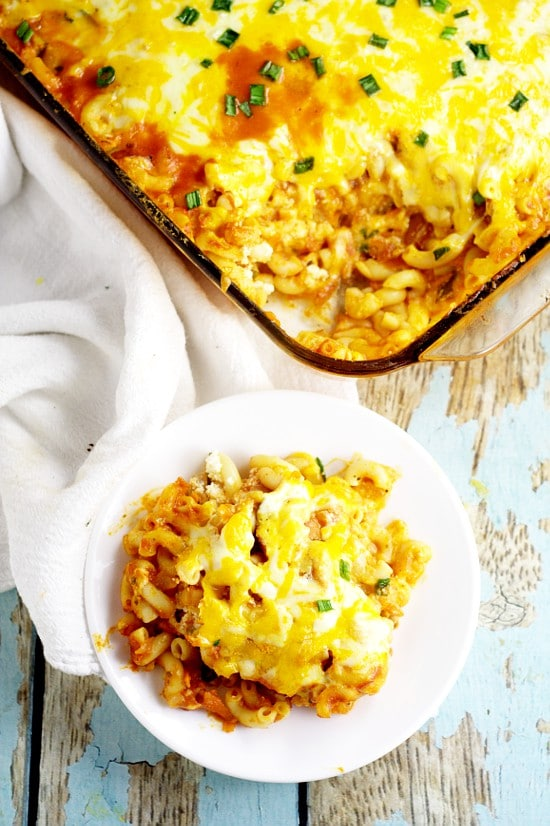 Frugal and freezer-friendly, this Cheesy Kielbasa Pasta Bake recipe is perfect for family dinner with kielbasa, pasta, and added veggies for extra nutrition and flavor, covered in red sauce for a full delicious meal.