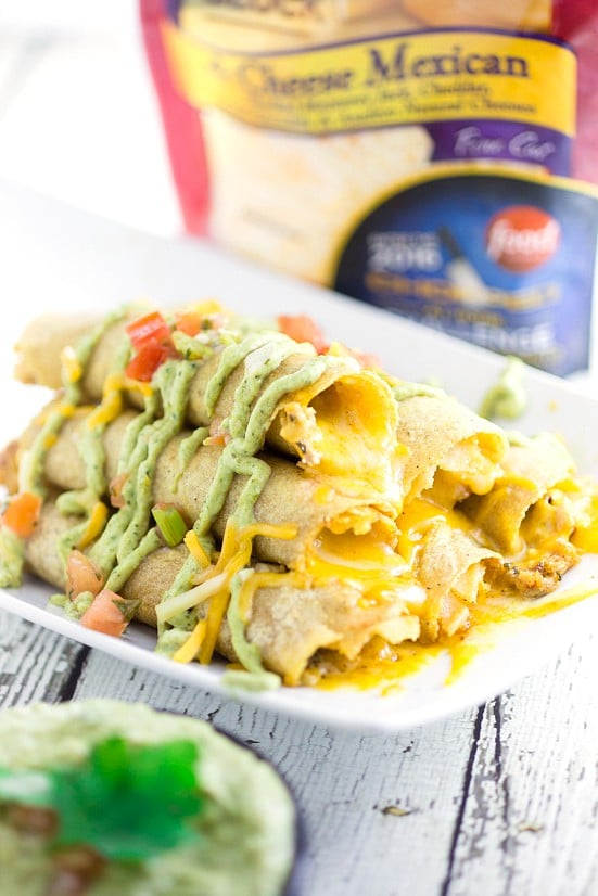 Cheesy Baked Chicken Taquitos recipe -Easy and cheesy Baked Chicken Taquitos will become a yummy, Mexican-inspiredfamily dinner favorite in no time! Serve with the Roasted Creamy Poblano Dip for an extra zesty and a little spicy kick. These look amazing! So cheesy!