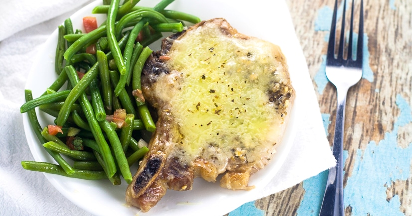 Cheesy Italian Pork Chops Recipe -Juicy, flavorful pork chops, baked in the oven with garlic and Italian seasoning and smothered in cheese inthis Cheesy Italian Pork Chops recipe. Make it in just 40 minutes! These are seriously delicious!