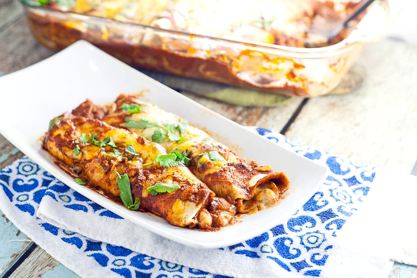 3 Bean Enchiladas Recipe -Quick, easy, and frugal, this 3 Bean Enchiladas recipe with 3 types of beans and lots of cheese is the perfect way to eat vegetarian for a delicious and cheap family dinner recipe!