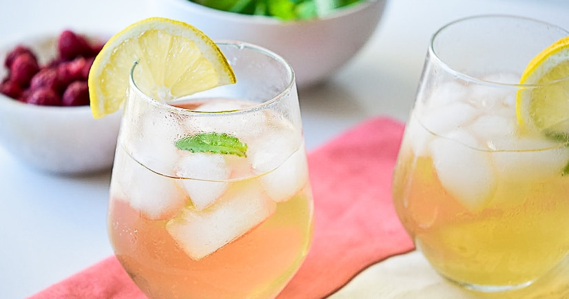Earl Grey Spritzer Recipe - This pretty, festive, and fun sparkling Earl Grey Spritzer is the perfect drink for a party or bridal shower, or even a delightful just-because pick-me-up. This easy drink recipe is perfect for our tea party bridal shower!
