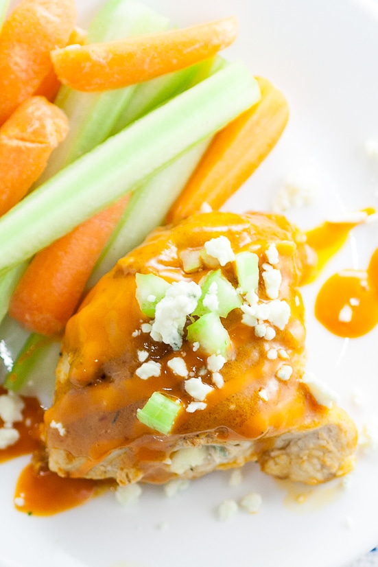 Buffalo Stuffed Chicken Breasts Recipe -Zesty spicy Buffalo Stuffed Chicken Breasts smothered in buffalo sauce and stuffed with creamy blue cheese is an elegant way to enjoy your favorite appetizer for dinner.