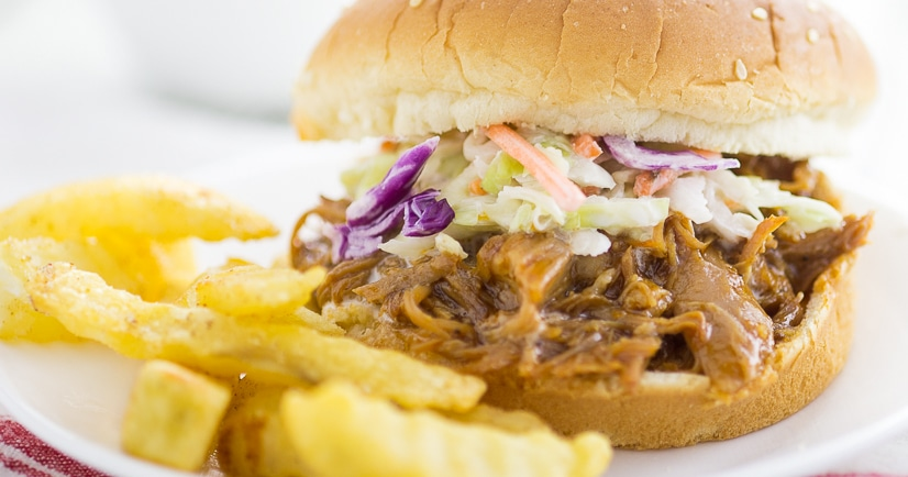 Easy Crock Pot Barbecue Pulled Pork Recipe -Super easy, 3 ingredient Crock Pot Barbecue Pulled Pork is the perfect hands-off dinner for a busy day that everyone will love! Just grab buns at dinner time and you're ready to go!