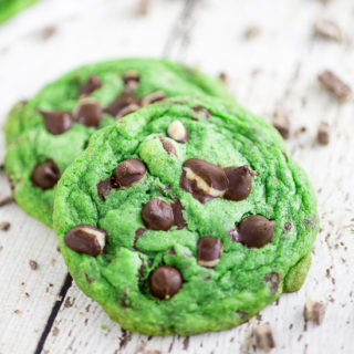 Mint Chocolate Chip Cookies Recipe - Cool, refreshing cookies with decadent chocolate chips all in this chewy Mint Chocolate Chip Cookies recipe. Perfect for Mint Chocolate lovers! SO good! I love mint chocolate. Super festive for St Patrick's Day or Christmas too!