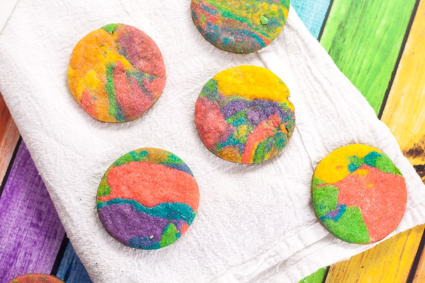Tie Dye Cookies Recipe and Tutorial -Fun, easy, and bright, these adorable Tie Dye Cookies are a delicious and colorful treat that kids will love for a fun addition to any party! Fun food for kids
