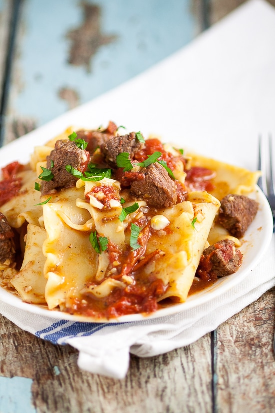 Beef and Tomatoes over Noodles Recipe - Classic flavors of juicy beef, zesty tomatoes, and cozy noodles come together in this Beef and Tomatoes over Noodles recipe to create an easy comfort food dish with simple ingredients. Quick and easy family dinner pasta recipe