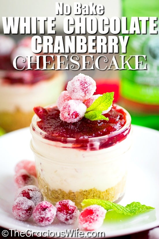 Cranberry White Chocolate Cheesecake Recipe - rich white chocolate no bake cheesecake filling with just 3 ingredients topped with tangy cranberry sauce in a graham cracker crust. Make it a big cheesecake or make mini cheesecakes in jars.