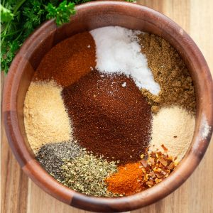 Taco seasoning in a wooden bowl