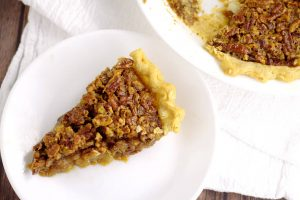 Southern Brown Sugar Pecan Pie-A super simple but absolutely delicious Southern Pecan Pie recipe. I make these for the holidays every year, and they are amazing! A gooey, caramel-like filling is topped with crunchy pecans, all in a perfect, flaky pie crust.