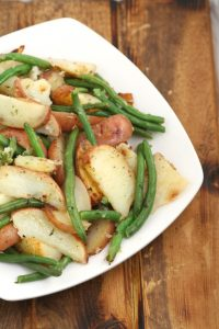 Garlic Herb Roasted Potatoes and Green Beans - an easy, healthy side dish recipe with potato and vegetable. Great for dinner, potlucks, or a party!