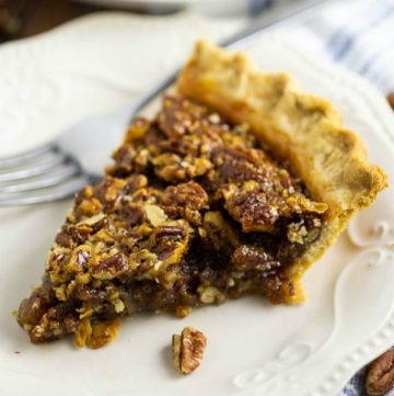 Gooey caramel filling with crunchy pecans in a buttery, flaky, golden crust make this homemade Southern Pecan Pie a heavenly treat for your holiday table! This recipe is SO EASY to make and seriously the best pecan pie ever. Plus video directions!