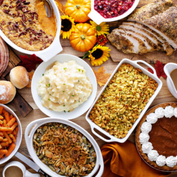 Thanksgiving side dishes on a wooden table with Fall decorations