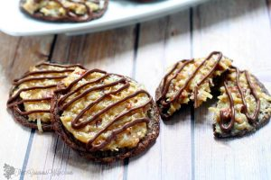 German Chocolate Cake Cookies Recipe - a delicious combination of sweet and decadent chocolate cookies and gooey caramel coconut pecan frosting make these cookies as amazing as the cake that they were inspired by.Perfect for the holidays!A yummy addition to your Christmas cookies exchange too! So good!