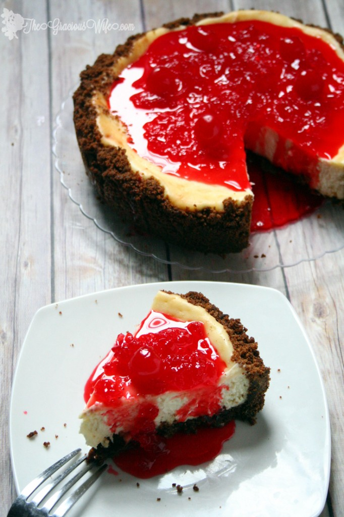 Gingersnap Cherry Cheesecake recipe has a buttery gingersnap crumb crust, classic and creamy cheesecake filling, and a sweet cherry sauce topping, perfect for the holidays.  What a beautiful Christmas dessert recipe idea! I looove the sweet maraschino cherry sauce!