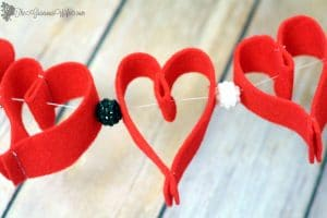 Valentine's Day Heart Felt Garland- Easy and frugal DIY heart felt garland for Valentine's Day. From TheGraciousWife.com