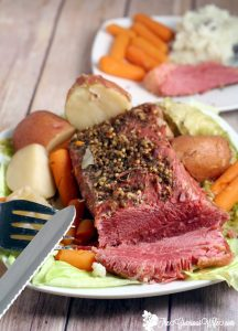 Slow Cooker Corned Beef and Cabbage is the perfect traditional dish to celebrate St Patrick's Day.  Fix it and forget it with this easy Crockpot Corned Beef and Cabbage dinner recipe. This is most juicy and delicious!