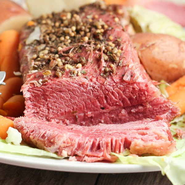 Slow Cooker Corned Beef and Cabbage is the perfect dish to celebrate St Patrick's Day. Easy Slow Cooker Corned Beef and Cabbage creates tender, fall-apart beef and warm, flavorful veggies and potatoes, all in this simple Crock Pot recipe.