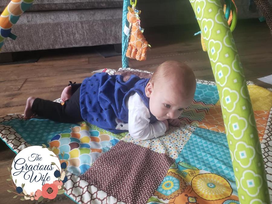 baby on an activity mat