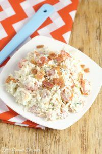 Creamy Coleslaw Recipe with Bacon - an easy Summer salad and side dish recipe combines classic cabbage and coleslaw dressing with the bold flavors of cherry tomatoes, bacon, and blue cheese to make a delicious and refreshing side dish for every picnic or cookout!
