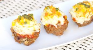 "Savory meatloaf cupcakes recipe made with the BEST meatloaf recipe and topped with ketchup, mashed potato ""frosting"" and cheese and veggie ""sprinkles.""  A delicious single serving family dinner recipe idea.  This would be a good idea for an appetizer recipe for a party too. You could bake them in mini muffin trays!"