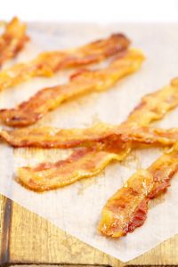 Crispy, salty, sweet Candied Bacon - easy to make right in your oven and perfect for breakfast, garnishes, and pretty much everywhere else! cooking tips | kitchen tips