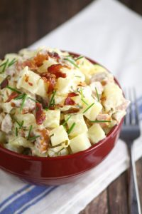 Easy Creamy Slow Cooker Potatoes with Sausage and Chives combines hearty potatoes with a creamy sauce, smoked sausage, and chives for a classic, wholesome meal. Perfect easy slow cooker meal recipe with pork sausage and potatoes. I love that it can be an easy dinner or an easy side dish!