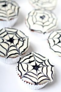 Spiderweb Cupcakes are a cute and fun but totally easy treat, perfect for Halloween or an adorable Spiderman birthday party.  They'll be a hit at your next party! Such a cute treat for kids!