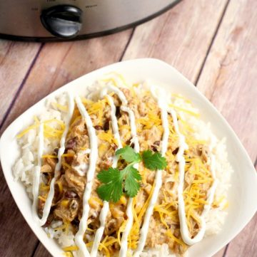 Crockpot Southwest Chicken Chilirecipe is so easy you don't have to thaw the chicken! With cream cheese and classic Southwest flavors like corn and beans. Serve with warm, buttered cornbread. Such an easy family dinner recipe idea in the slow cooker!