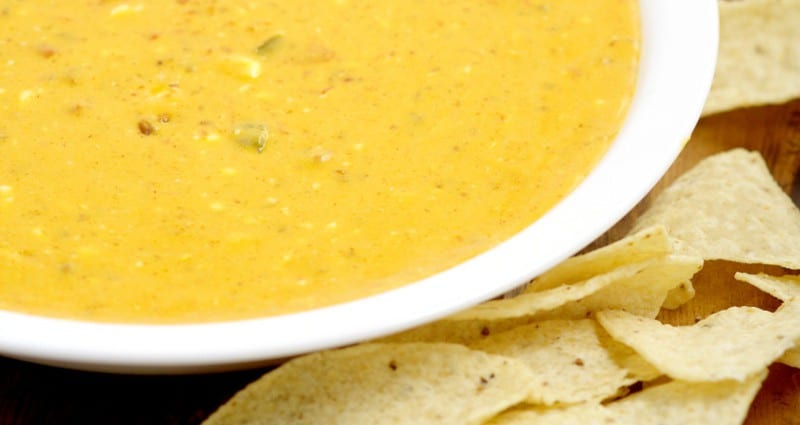 Creamy, gooey, cheesy Easy Slow Cooker Chili con Queso Dip recipe has just 4 ingredients and will be the star of the show at your next party! Amazing dip and appetizer recipe! This stuff goes fast!