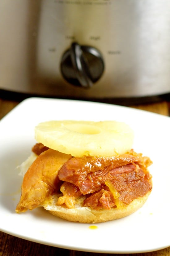 Hawaiian Crockpot Ham Sandwichesrecipe with slow cooked salty ham along with sweet pineapple and brown sugar, and tangy Dijon mustard, all on one delicious bun. Great crockpot recipe for family dinner. This would be a great way to use up leftover ham too!