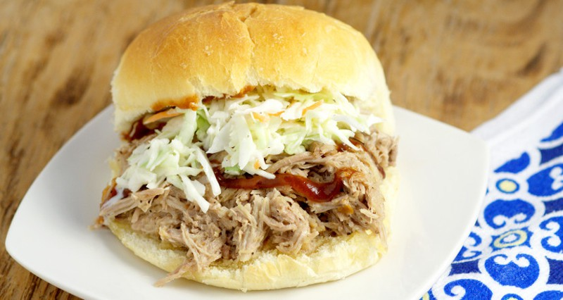 Easy, tangy Slow Cooker Southern Pulled Pork recipe cooked effortlessly in the Crockpot. Top with creamy coleslaw for a bit of sweet crunch and a true Southern experience! This is seriously  one of my favorite recipes of all time!