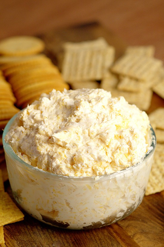 Ranch Cheddar Beer Dip - Perfect for a partyand football games, this Ranch Cheddar Beer Dip has creamy ranch and cream cheese mixed with the bite of sharp cheddar and bitter beer to make an outstanding drool-worthy dip recipe! Super easy dip recipe and appetizer recipe, and super yummy too!
