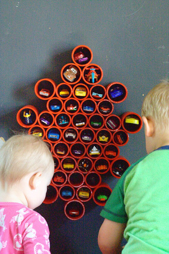 DIY Toy storage idea and DIY Toy Organization idea for the playroom.Organize all of your boys' Matchbox with this DIY Matchbox Car Storage for the wall. It's super easy and the kids will love it! (and you'll love it too, when there is no longer a Matchbox car explosion all over your playroom.