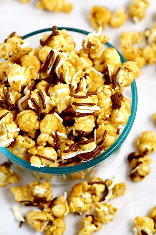 Make your own Homemade Zebra Caramel Popcorn recipe for an easy and sweet snack, treat, or gift idea with warm, sweet oven baked caramel corn, drizzled in milk chocolate and white chocolate for a to-die-for treat.