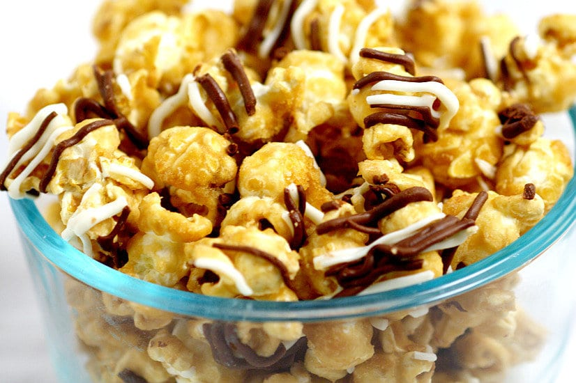 Make your own Homemade Zebra Caramel Popcornrecipe for an easy and sweet snack, treat, or gift idea with warm, sweet oven baked caramel corn, drizzled in milk chocolate and white chocolate for a to-die-for treat.