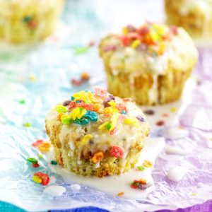 Rainbow Fruity Pebbles Muffins are a pretty fun breakfast idea perfect for St Patrick's Day.Fun and easy to make these Rainbow Fruity Pebbles Muffins with a crunchy streusel topping and sweet, simple glaze will make you feel like you've hit the breakfast jackpot!