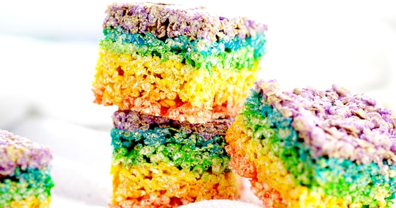 Rainbow Rice Krispie Treats recipe.Easy, no bake Rainbow Rice Krispie Treats make a pretty and festive treat for St Patrick's Day, or even just for fun, that everyone will love! What an adorable dessert recipe for St Patrick's Day or even a rainbow birthday party!