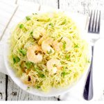 Garlic Parmesan Shrimp and Angel Hair pasta makes a delicious family meal.  Juicy shrimp with garlic, butter, and Parmesan cheese adorn a hearty helping of angel hair pasta in this 30 minute Garlic Parmesan Shrimp and Angel Hair dinner recipe.